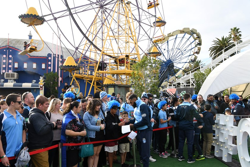 Josh Addo-Carr signs autographs at Luna Park in Melbourne.