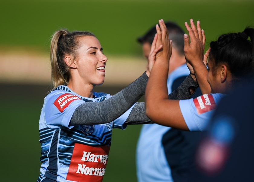NSW Blues players preparing for the Women's State of Origin match.