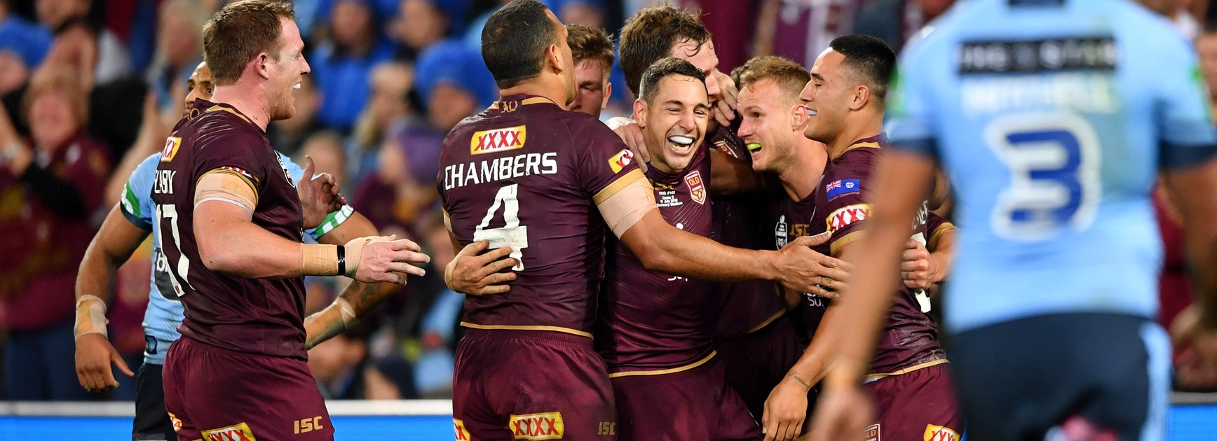 Queensland celebrate a try against NSW.
