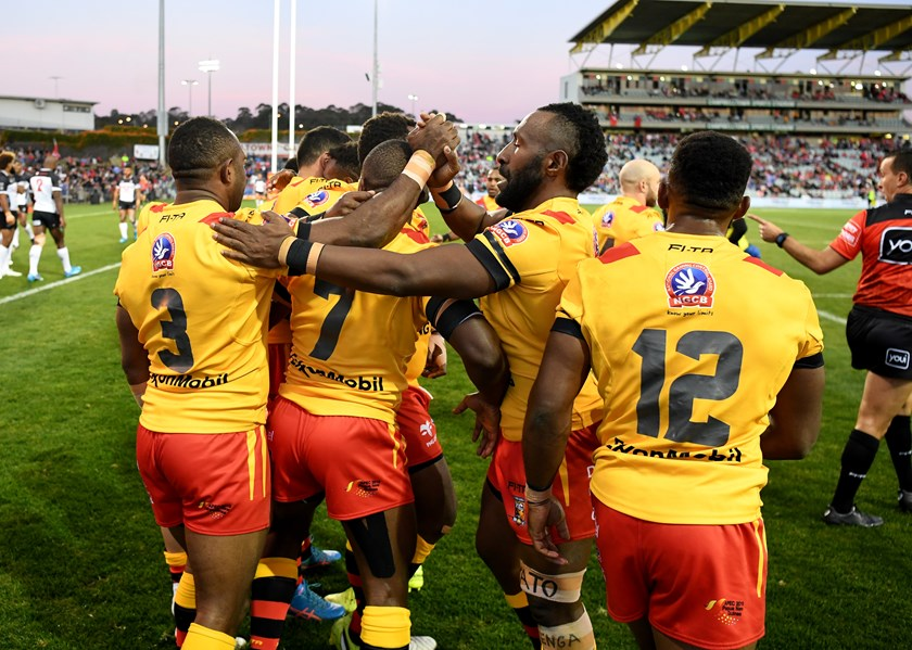 Papua New Guinea celebrate a try against Fiji.
