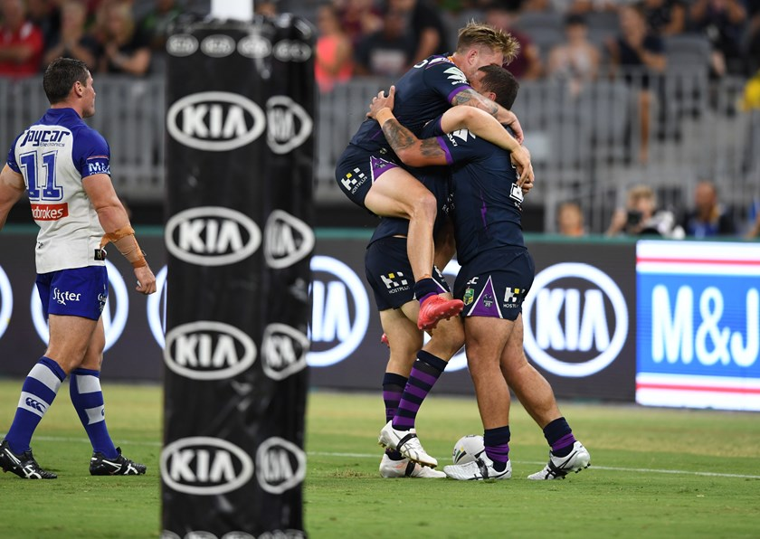 Melbourne celebrating a try against Canterbury at Perth Stadium.