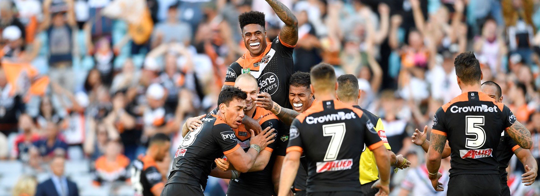 The Wests Tigers celebrate beating the Roosters in round one.
