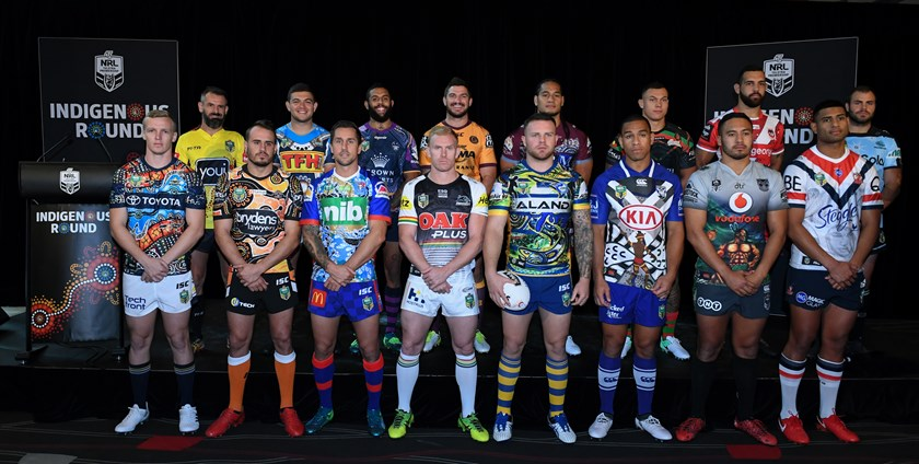 NRL players show off their clubs' Indigenous Round jerseys.