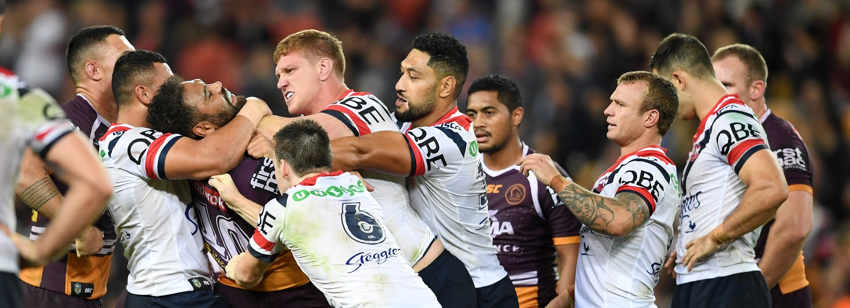 Dylan Napa and Sam Thaiday lock horns.