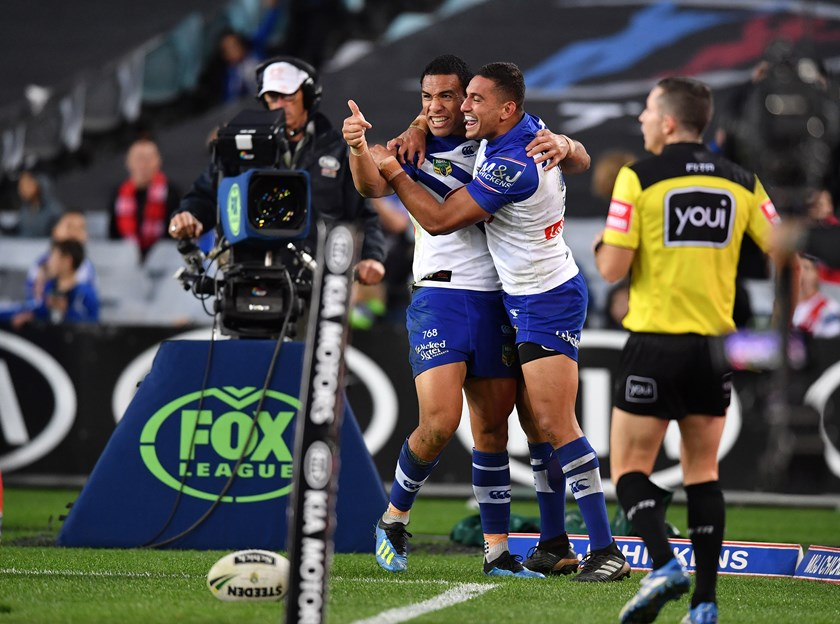 Bulldogs Will Hopoate and Marcelo Montoya celebrate a try.