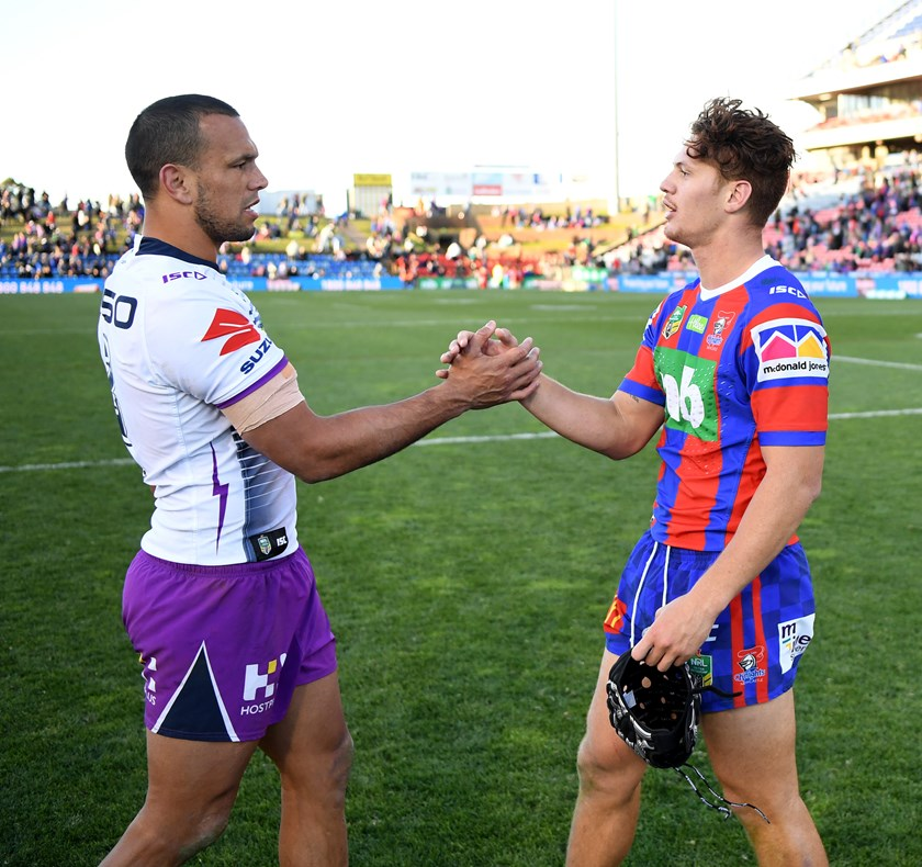 Kalyn Ponga with Melbourne's Queensland centre Will Chambers.