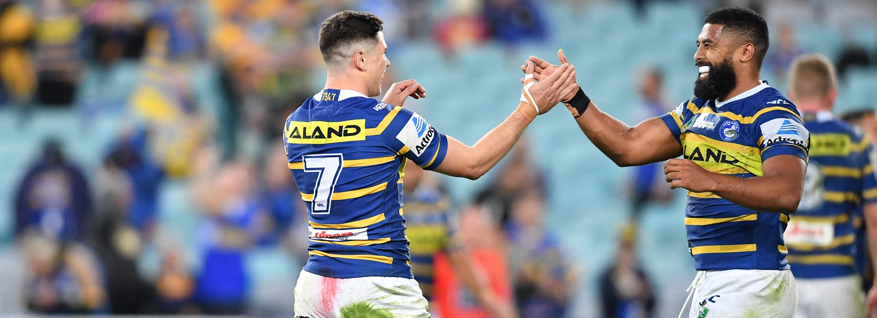 Eels Mitchell Moses and Michael Jennings celebrate.