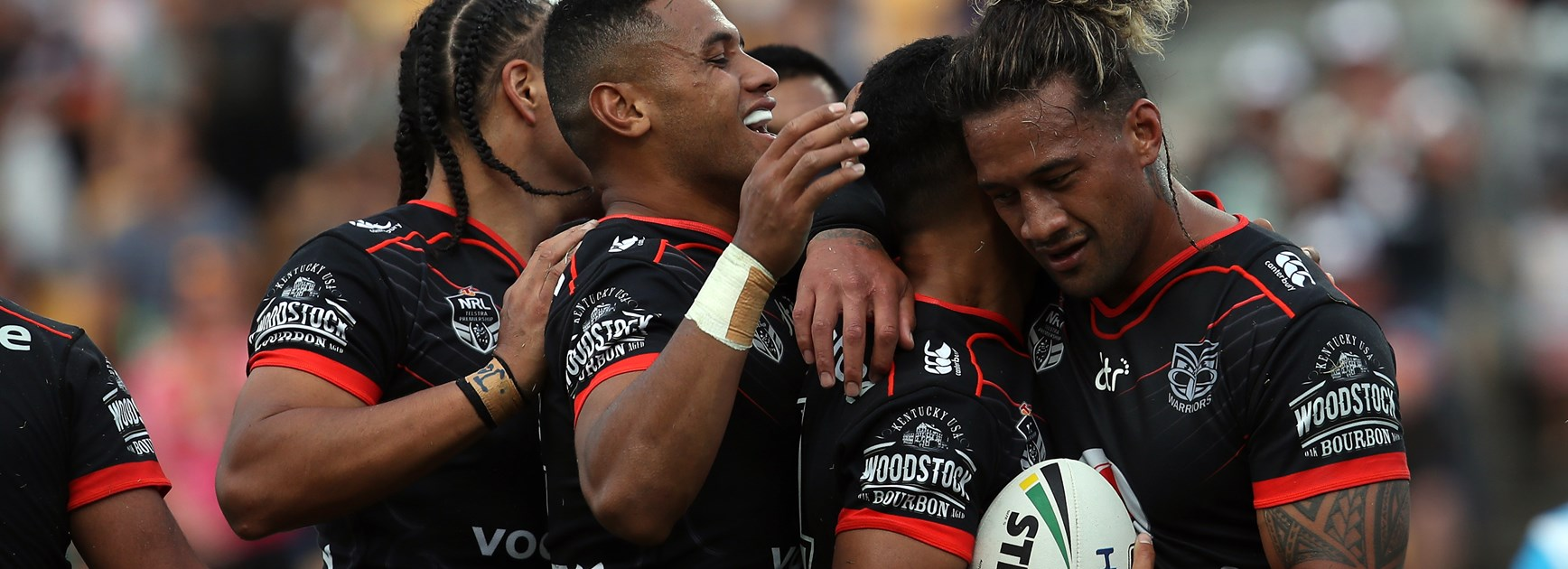 The Warriors celebrate a try against the Titans.