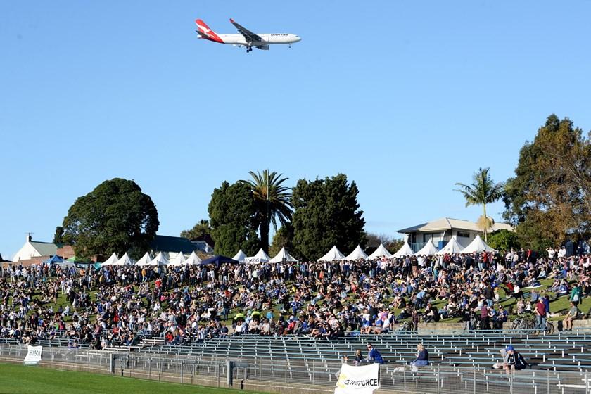 A jet flies over Henson Park during a Newtown match.