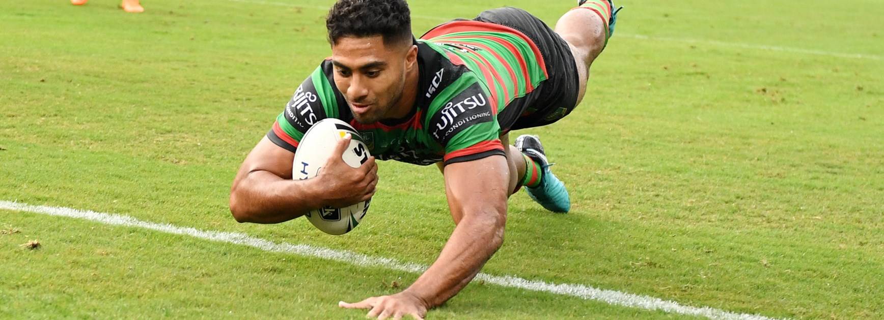 Rabbitohs winger Robert Jennings scores a try.