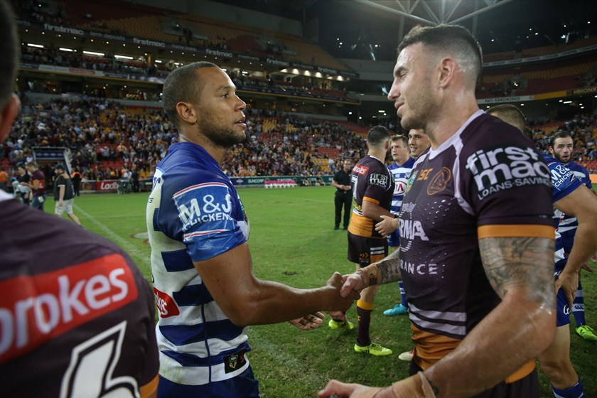 Moses Mbye and Darius Boyd shake hands after the game.
