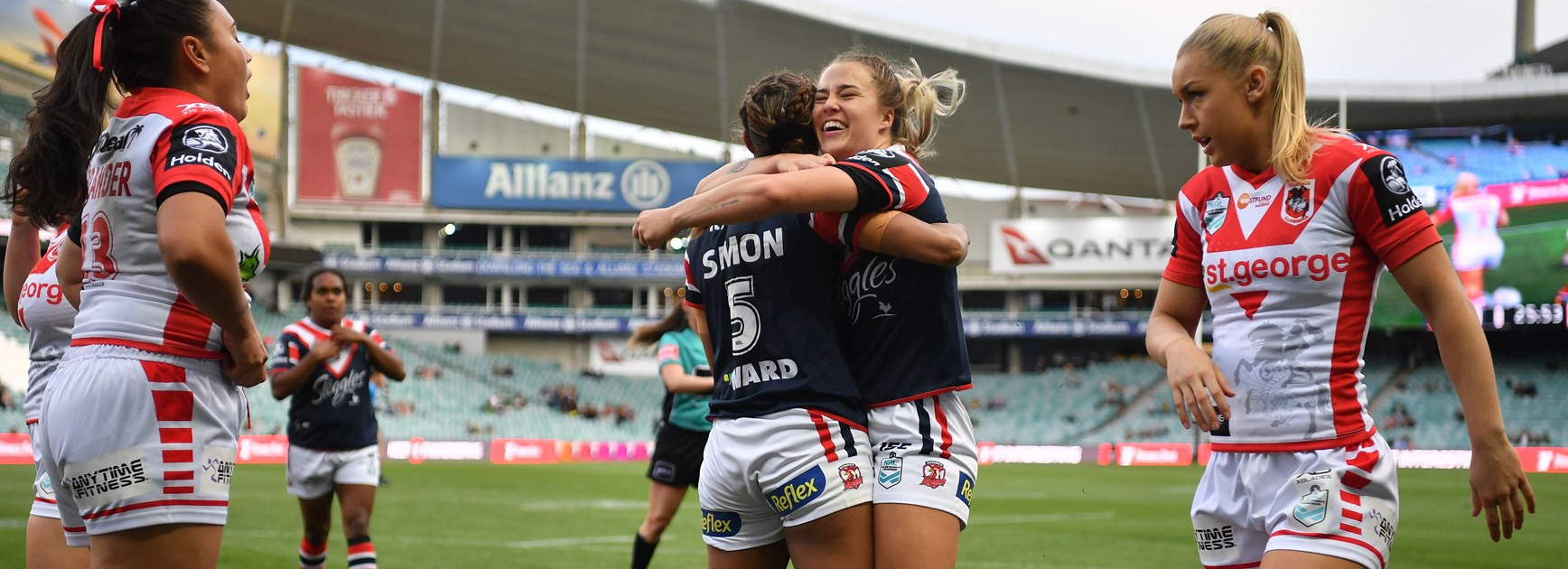 Roosters centre Isabelle Kelly celebrates a try.