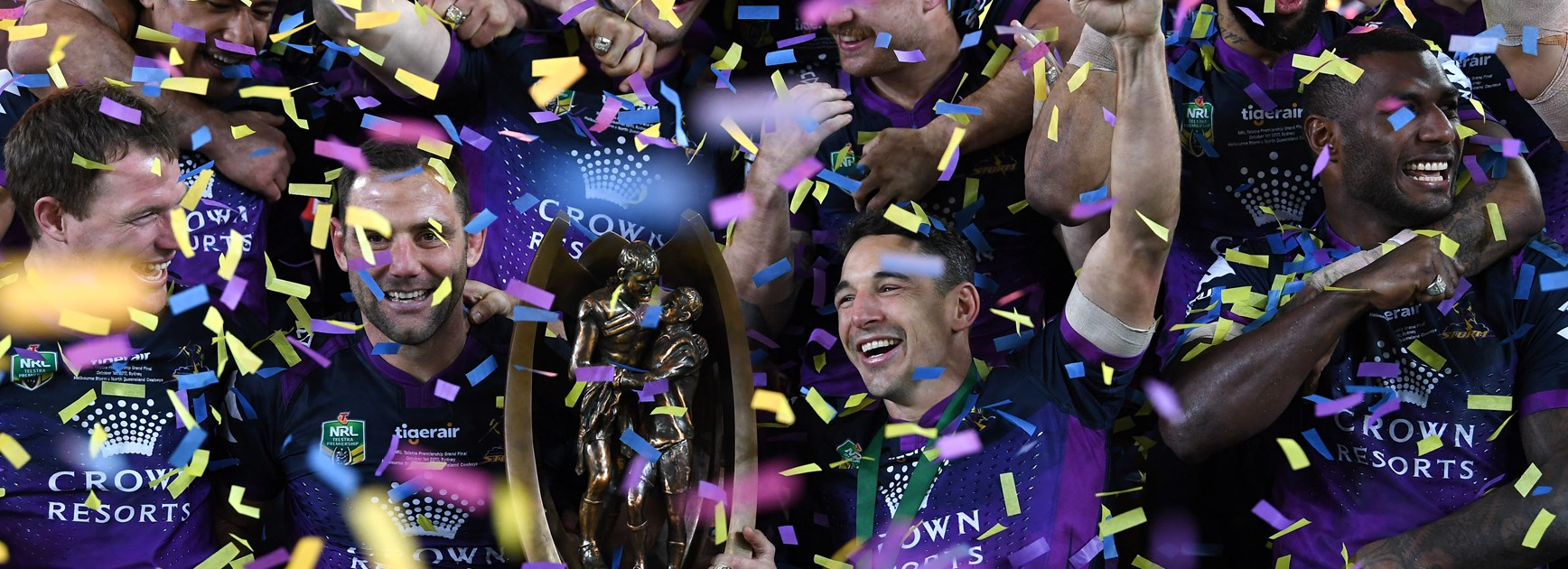 Melbourne Storm duo Cameron Smith and Billy Slater holding the premiership trophy.