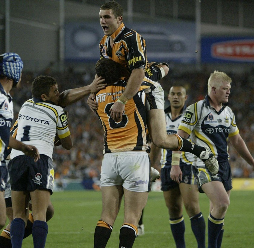 Robbie Farah celebrates the 2005 grand final win with Wests Tigers.