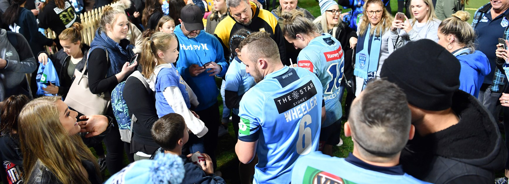 Fans engulf the players after the game.
