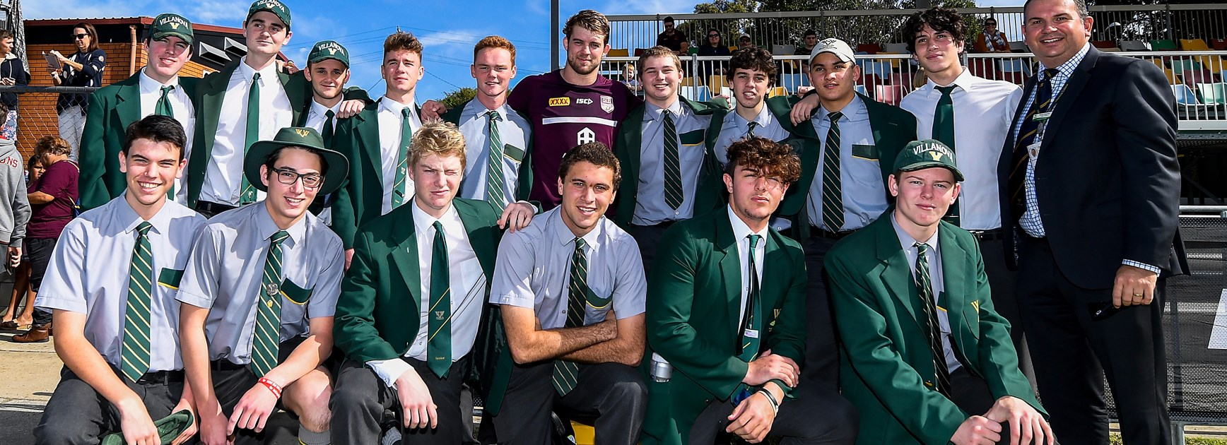 Maroons debutant Christian Welch and students from Villanova College.