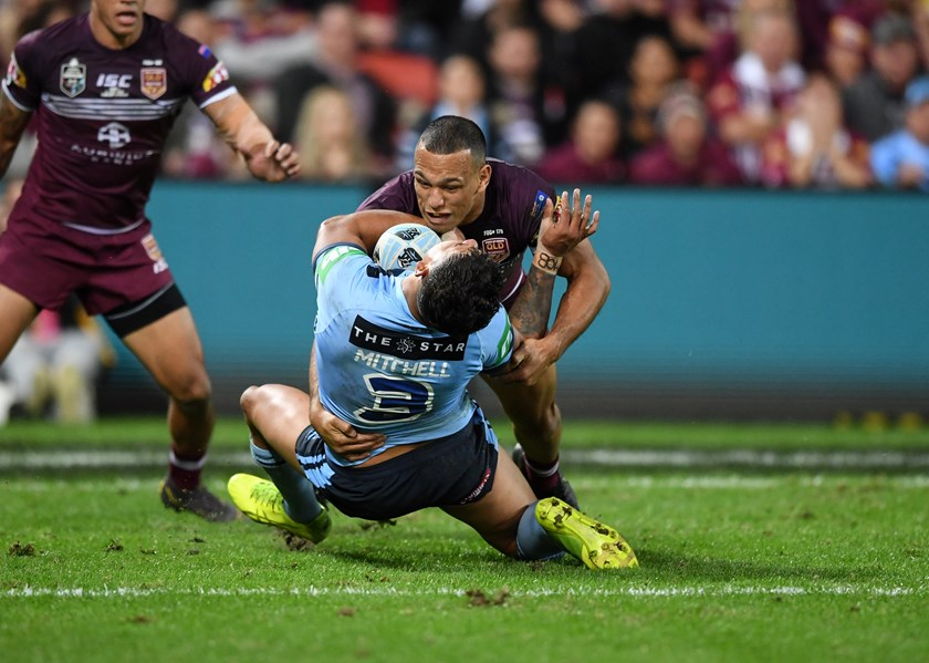 Will Chambers tackles Latrell Mitchell.