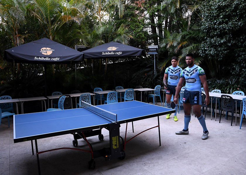 Payne Haas taking time out with Latrell Mitchell to play table tennis in Blues camp.
