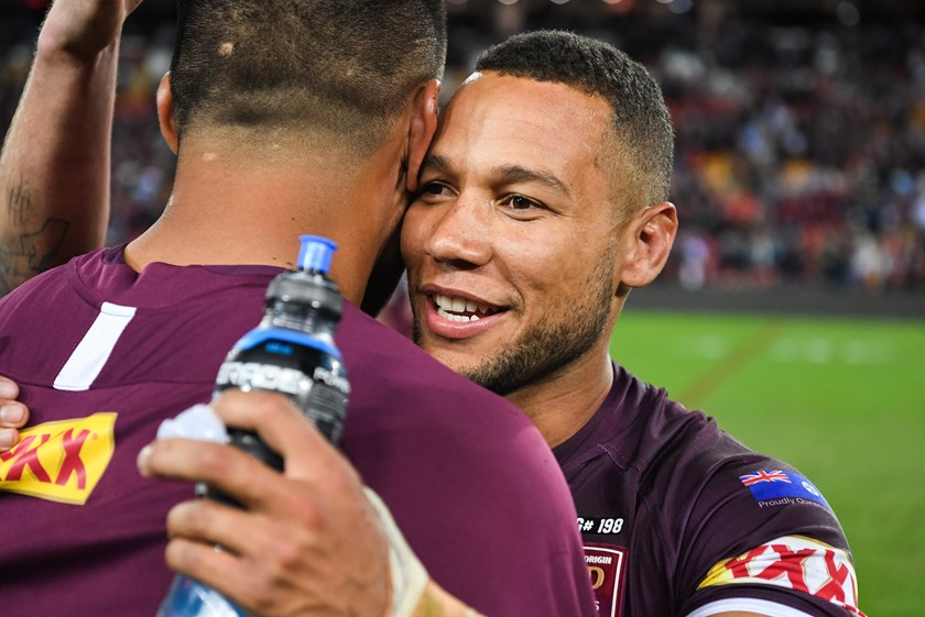 Moses Mbye celebrates Queensland's win.