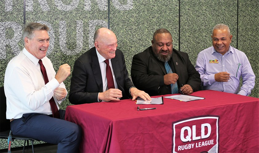 QRL managing director Rob Moore, QRL chairman Bruce Hatcher, PNG Hunters chairman Sandis Tsaka and PNG Hunters CEO Reatau Rau sign off on a new four-year participation agreement for the PNG Hunters in the Intrust Super Cup.