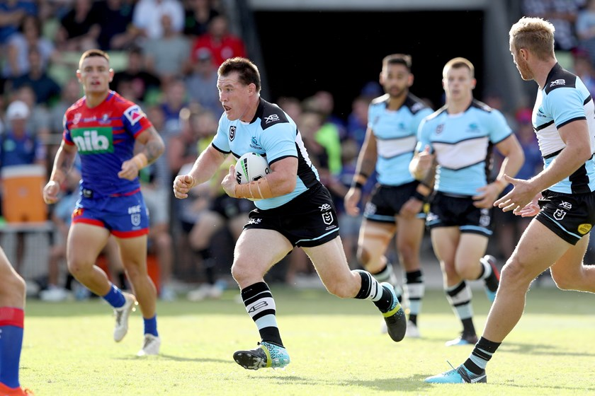 Paul Gallen takes a charge for the Sharks.