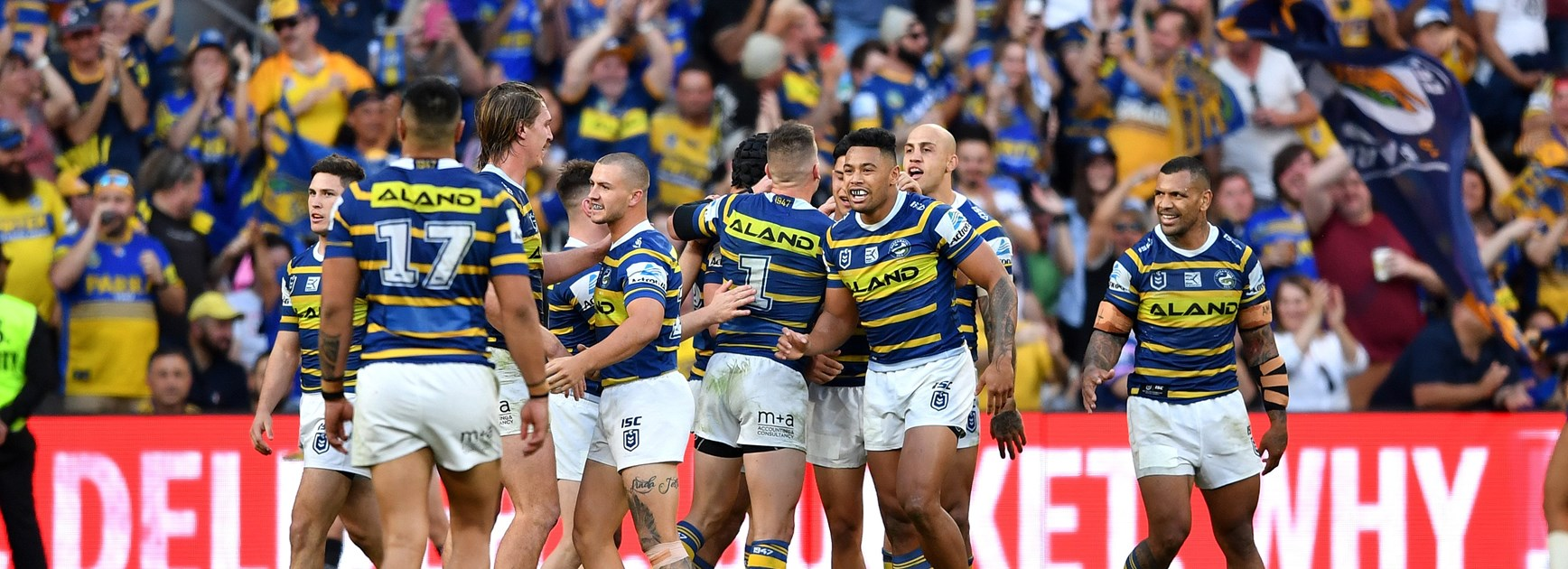 Eels players celebrate a try.