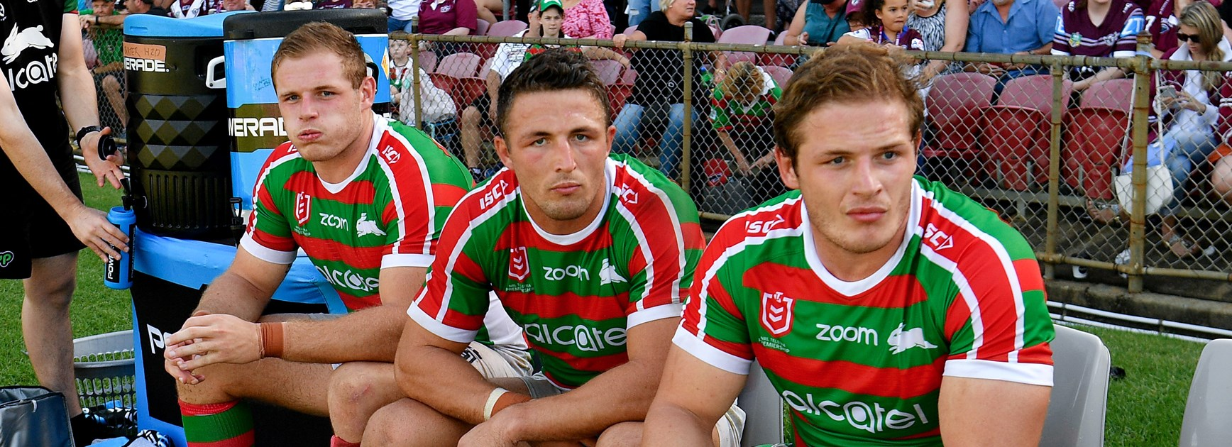Tom, Sam and George Burgess on the Rabbitohs bench.