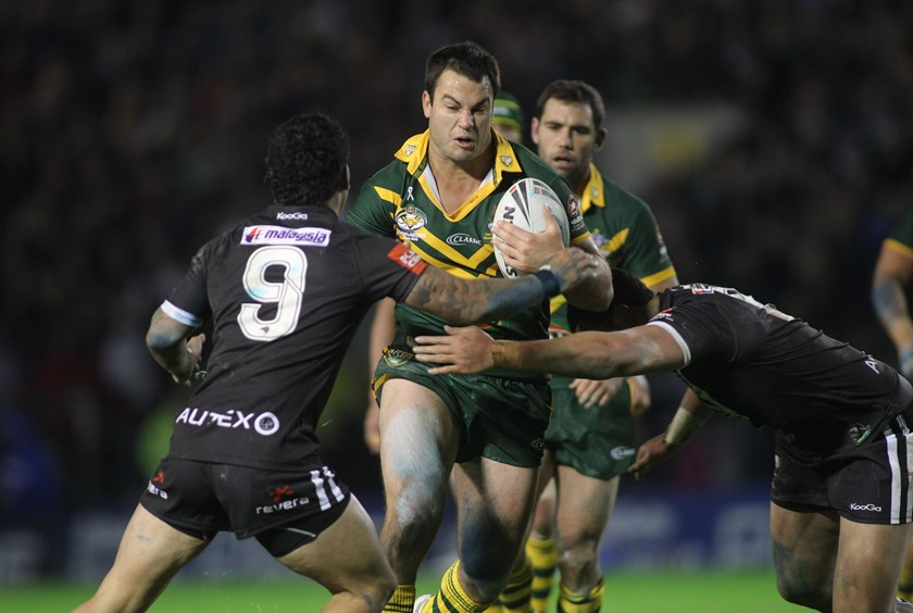 David Shillington carts it up as Issac Luke moves in for the Kiwis.