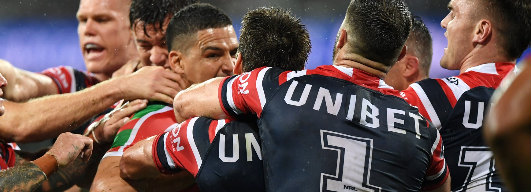 Rabbitohs five-eighth Cody Walker caught up in a melee with the Roosters.