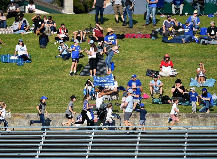 Fans bathe in the sunshine on the Henson Park hill.