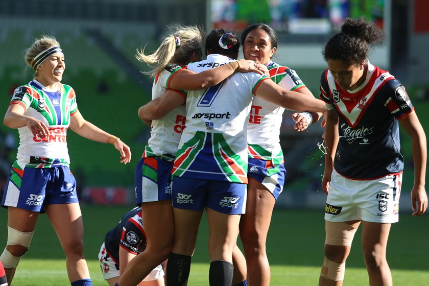 The Warriors congratulate halfback Charntay Poko after her try against the Roosters.