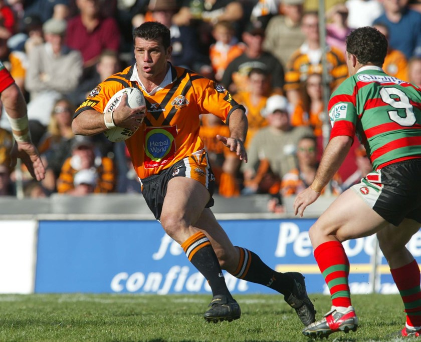 Scott Sattler on the move for Wests Tigers in 2004.