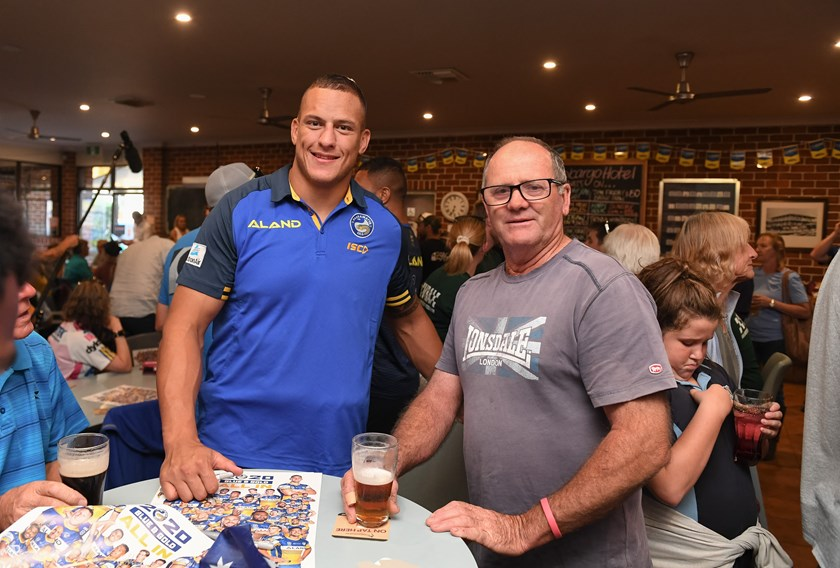 Eels prop Kane Evans with a patron at the Cobargo Hotel.