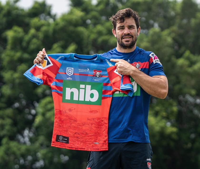 Aidan Guerra with the Knights' Nines jersey.
