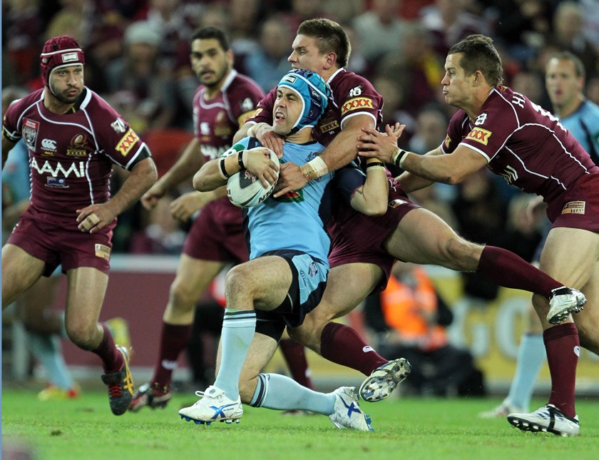Soward is wrapped up by the Queensland defence in Origin in 2011.