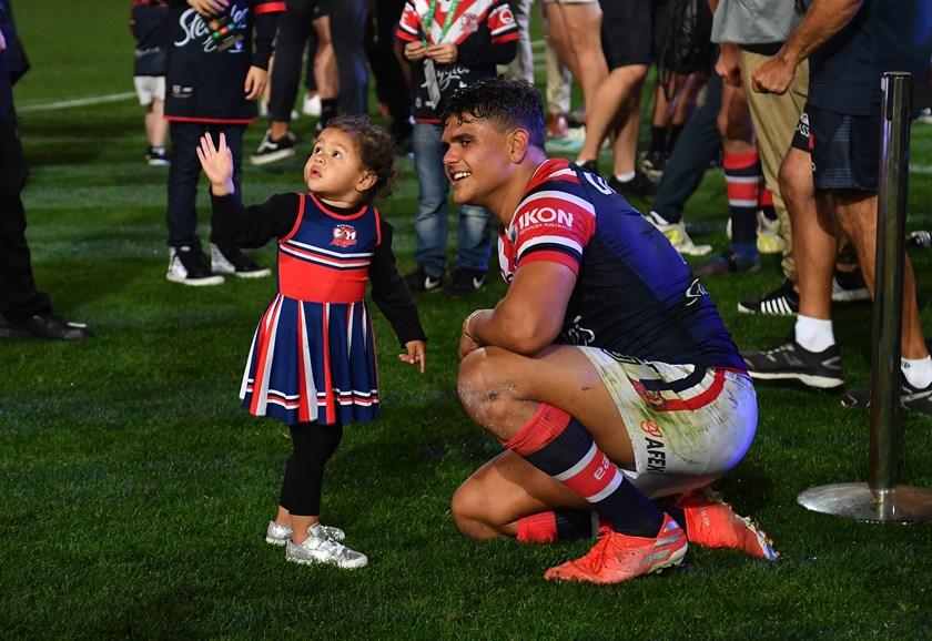 Latrell Mitchell with his daughter Inala after the 2019 grand final win over Canberra.