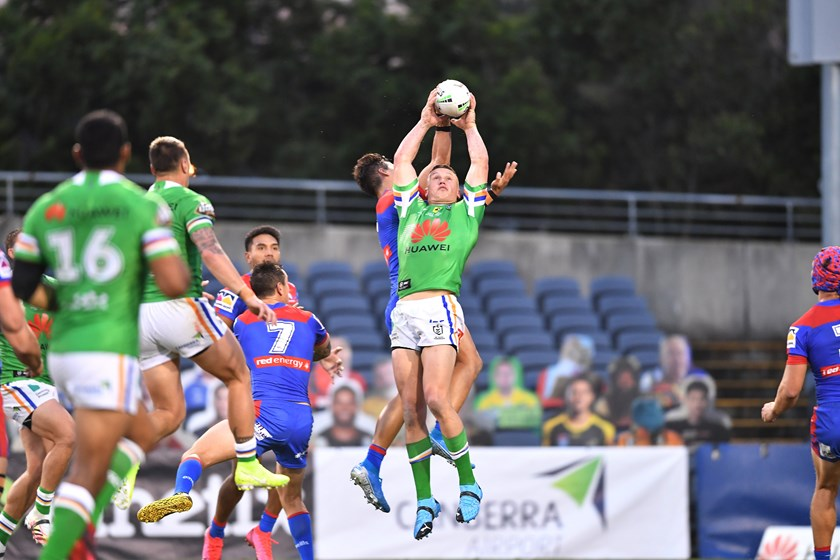 Jack Wighton leaps high to score.