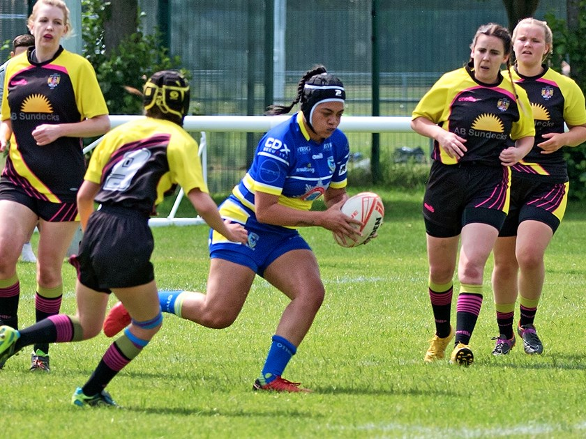 Roxy Murdoh hits the ball up for the Wolves against Leigh Miners.