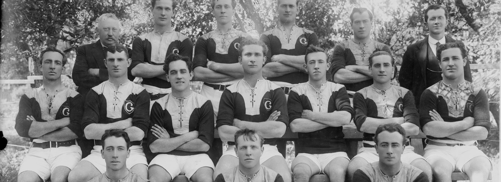 """The Glebe players that went on strike in 1917 and were tagged """"The Rebels"""". Burge is seated at the centre of the middle row."""